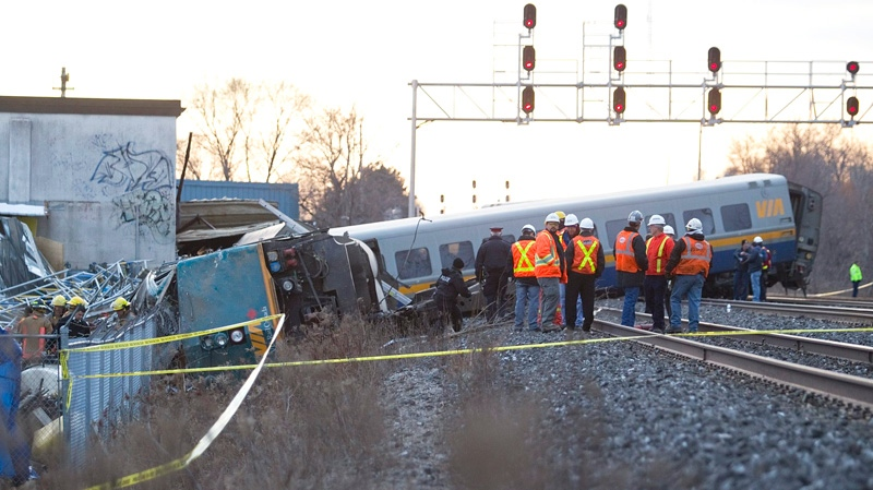 Crews work on a derailed VIA rail train in Burlington, Ont. on Sunday, Feb. 26, 2012. (Pawel Dwulit / THE CANADIAN PRESS)