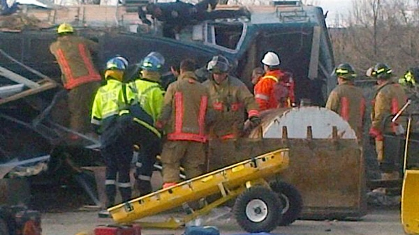Emergency crews are shown at the scene of a VIA Rail train derailment in Burlington, Ont. on Sunday, Feb. 26, 2012. (CP24 / Dave Ritchie)