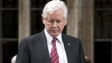Liberal leader Bob Rae rises during a Point of Order to announce that a Liberal staffer had been responsible for attacks on Minister of Public Safety Vic Toews in the House of Commons on Parliament Hill in Ottawa, Monday Feb. 27, 2012. (Adrian Wyld / THE CANADIAN PRESS)