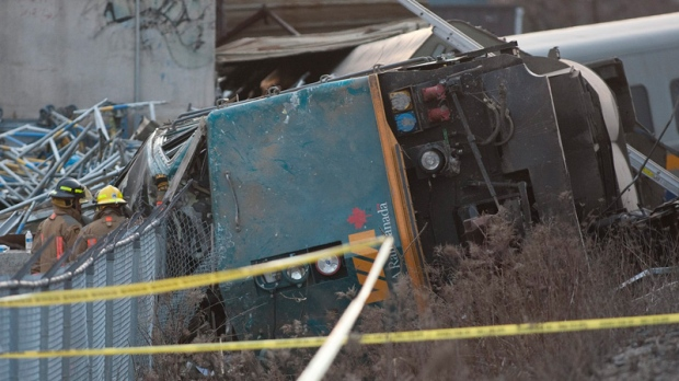 Rescue crews work on a derailed VIA rail train in Burlington, Ontario on Sunday, Feb. 26, 2012. (Pawel Dwulit / THE CANADIAN PRESS)