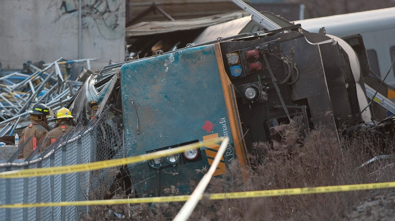 Rescue crews work on a derailed VIA rail train in Burlington, Ontario on Sunday, Feb. 26, 2012. (Pawel Dwulit / THE CANADIAN PRESS)