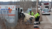 A person injured in the Via Rail passenger train derailment is moved to an ambulance in Burlington, Ont., on Sunday, Feb. 26, 2012.
