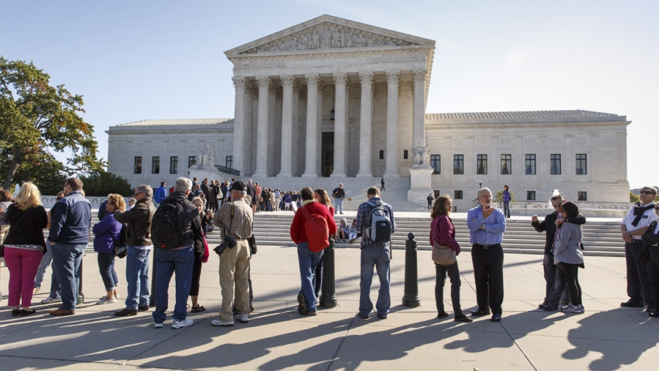 People wait to enter the Supreme Court as it begins its new term in Washington, Monday, Oct. 6, 2014. (AP / J. Scott Applewhite)