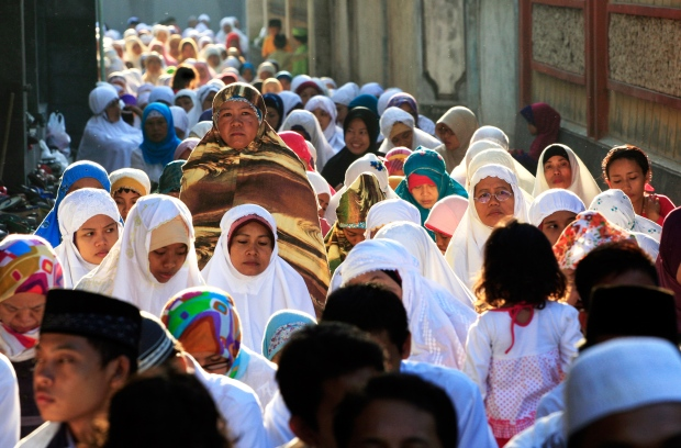 Muslims around the world celebrate Eid al-Adha, a three-day holiday commemorating the willingness of the prophet Ibrahim to sacrifice his son in accordance with God&#39;s will, though in the end God provides him a sheep to sacrifice instead. <br><br> Muslims perform a morning prayer marking the Eid al-Adha holiday on a street in Bali, Indonesia, Sunday, Oct. 5, 2014. (AP / Firdia Lisnawati)