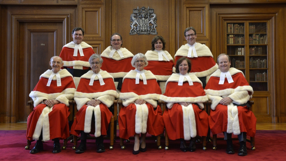 The Supreme Court Justices pose for a group photo at the Supreme Court of Canada, in Ottawa, Monday, Oct. 6, 2014. (Adrian Wyld / THE CANADIAN PRESS)
