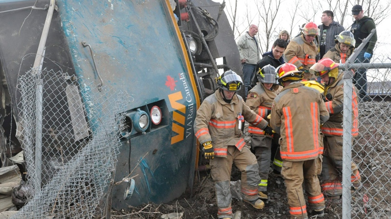 Emergency crews help extract VIA employees from the locomotive out of a train wreck in Burlington, Ont. on Sunday, Feb. 26, 2012. 9David Ritchie / THE CANADIAN PRESS)