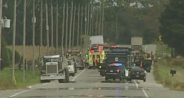 Emergency crews respond at the scene of a fatal crash on Medway Road northeast of London, Ont. on Monday, Oct. 6, 2014. (Wayne Jennings / CTV London)