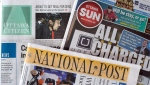 Newspapers, including the National Post and Ottawa Citizen, are shown on Oct. 6, 2014. (Justin Tang / THE CANADIAN PRESS)