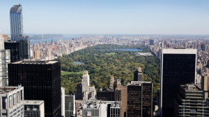 Central Park and buildings in midtown Manhattan are seen from the Rainbow Room, New York City's landmark restaurant atop 30 Rockefeller Plaza, Sunday, Oct. 5, 2014. (AP Photo/Mark Lennihan)