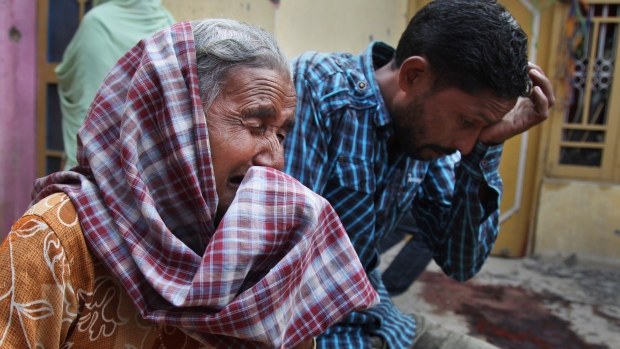 People mourn as India, Pakistan exchange fire