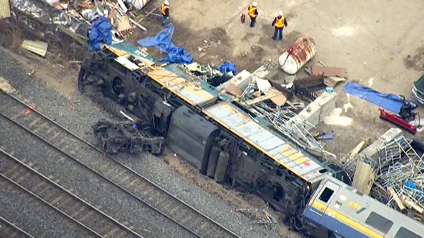 Emergency crews work at the scene of the derailment, as seen in this aerial view from the CTV News helicopter, in Burlington, Ont., Monday, Feb. 27, 2012.