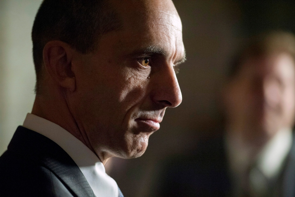 Steven Blaney, Minister of Public Safety and Emergency Preparedness, pauses while speaking to reporters about firearms licensing in the foyer of the House of Commons on Tuesday, Oct. 7, 2014. (Justin Tang / THE CANADIAN PRESS)