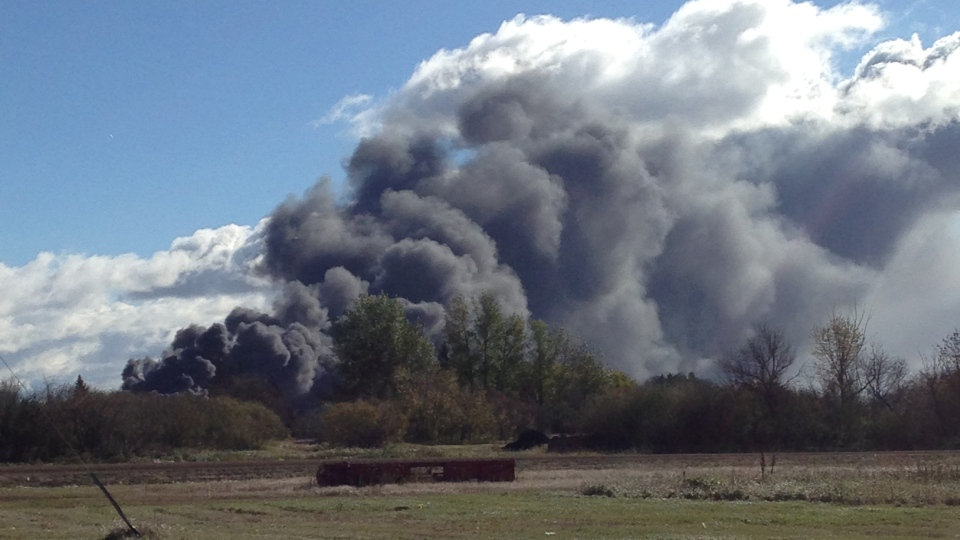 Black smoke billows from the scene of a train derailment near Clair, Sask. in Oct. 2014. (Glenn Thacyk)