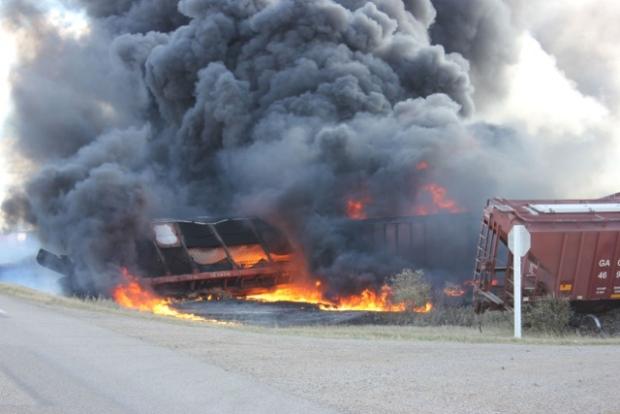 Black smoke billows from the scene of a train derailment near Clair, Sask. on Tuesday. (Wadena News)