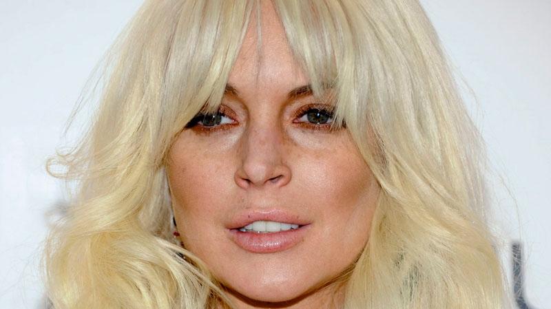 Lindsay Lohan attends amfAR's New York gala benefit at Cipriani Wall Street in New York, Feb. 8, 2012. (AP / Evan Agostini)