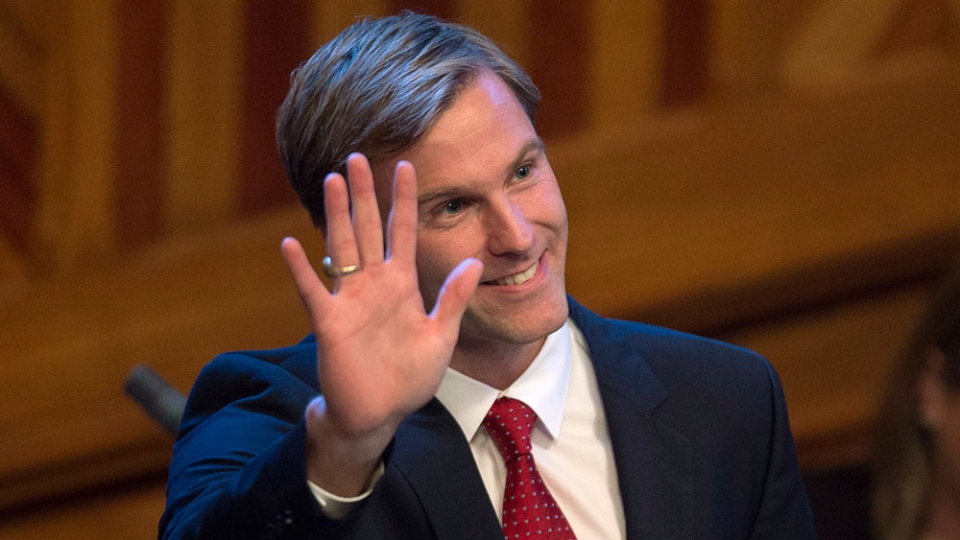 Brian Gallant waves to the gallery as he is sworn-in as New Brunswick's 33rd premier in Fredericton on Tuesday, October 7, 2014. (THE CANADIAN PRESS/Andrew Vaughan)