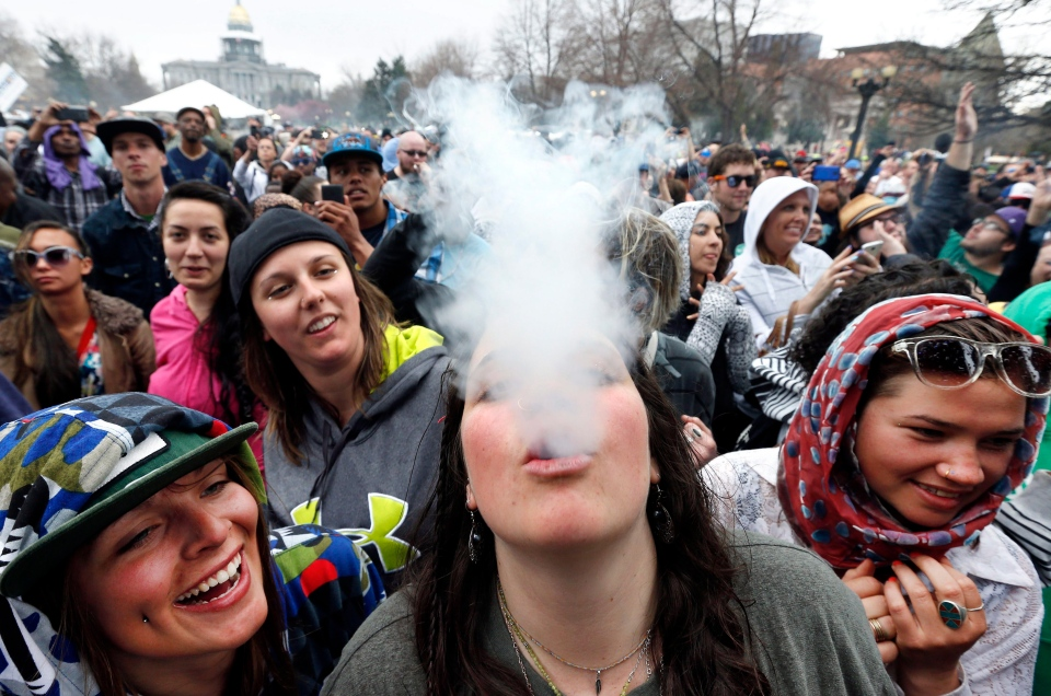 Partygoers dance and smoke pot on the first of two days at the annual 4/20 marijuana festival in Denver, April 19, 2014. (AP / Brennan Linsley)