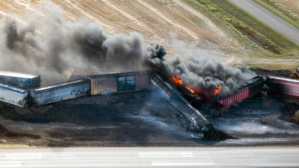 A CN freight train carrying dangerous goods derailed in central Saskatchewan, near the town of Wadena, on Tuesday and caught fire, Tuesday, Oct. 7, 2014. (Liam Richards / THE CANADIAN PRESS)