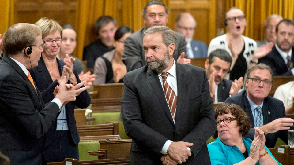 NDP Leader Tom Mulcair rises in the House of Commons on Parliament Hill to vote against an air combat mission against ISIS on Tuesday, Oct. 7, 2014. (Justin Tang / THE CANADIAN PRESS)