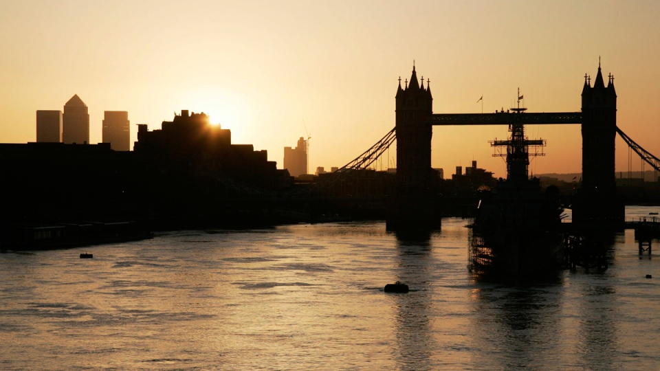 Sunrise over the London skyline and Tower Bridge, on March 11, 2008. (AP / Sang Tan)