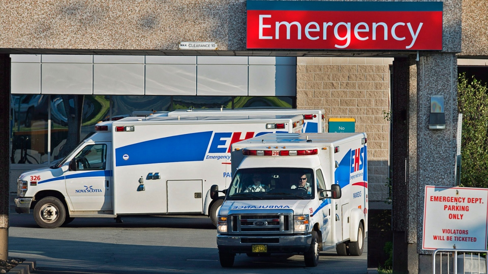 Paramedics are seen at the Dartmouth General Hospital in Dartmouth, N.S. on Thursday, July 4, 2013. (Andrew Vaughan / THE CANADIAN PRESS)