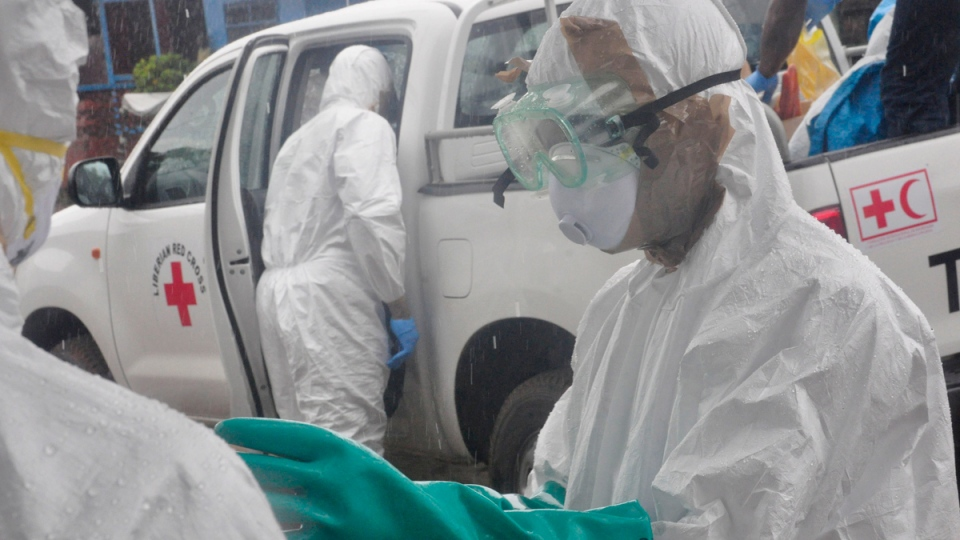 Health workers deal with Ebola victim in Liberia