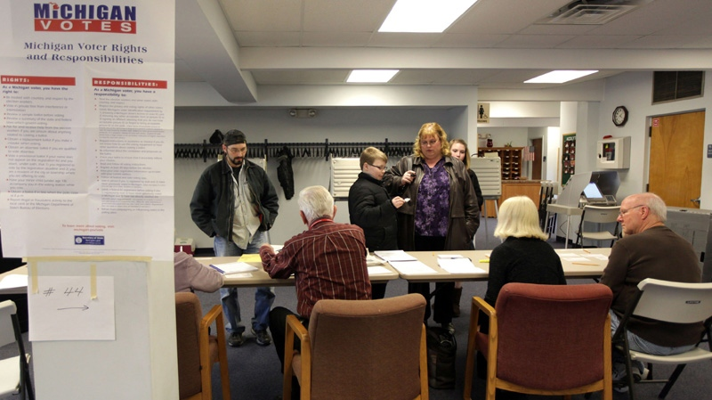 Voters prepare to cast their ballots at Christ Lutheran Church in Sterling Heights, Mich., on Tuesday, Feb. 28, 2012.  (Detroit Free Press, Andre J. Jackson)