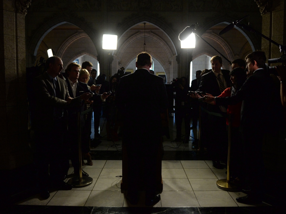 Foreign Affairs Minister John Baird speaks to media in the foyer of the House of Commons in Ottawa, Tuesday, Sept.16, 2014. (Sean Kilpatrick / THE CANADIAN PRESS)