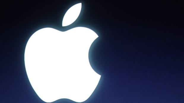 In this Tuesday, Oct. 4, 2011 file photo and Apple logo is seen during an announcement at Apple headquarters in Cupertino, Calif. (AP Photo/Paul Sakuma, file)
