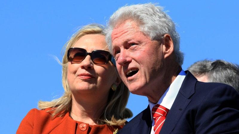 Former President Bill Clinton talks with his wife, U.S. Secretary of State Hillary Rodham Clinton, during a dedication ceremony on Sept. 30, 2011, in Little Rock, Ark. (AP / The Arkansas Democrat-Gazette, Staton Breidenthal)