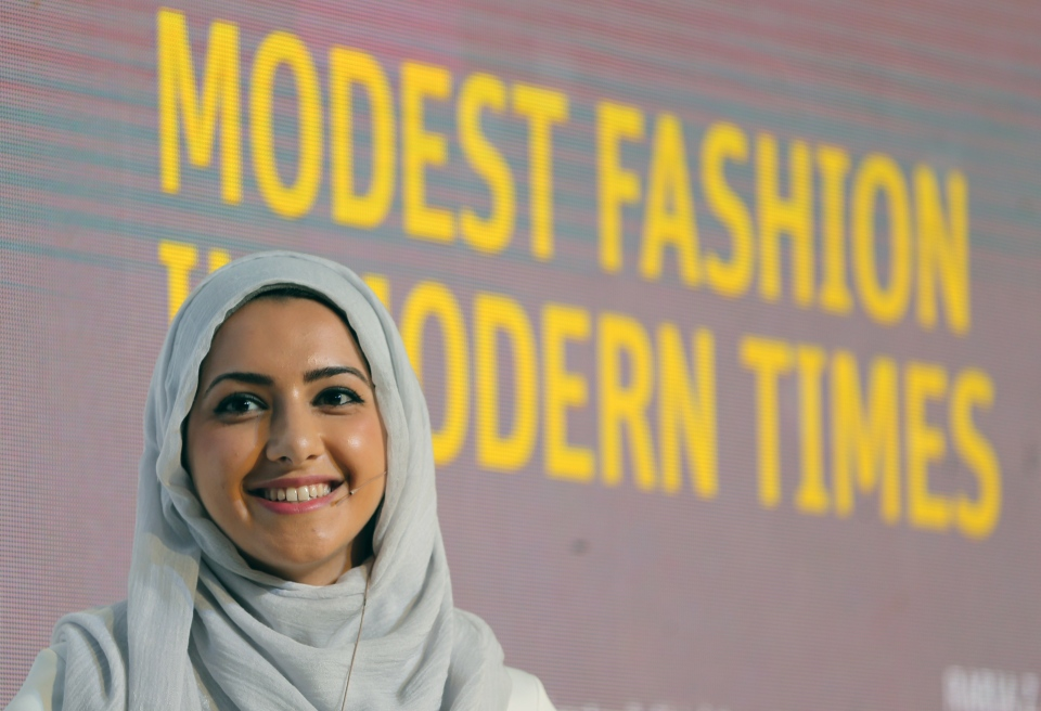 In this Oct. 5, 2014 photo, Summer Albarcha, owner of photo-sharing Instagram account 'Hipster Hijabis,' talks during a Fashion Forward session in Dubai, United Arab Emirates. (AP Photo/Kamran Jebreili)