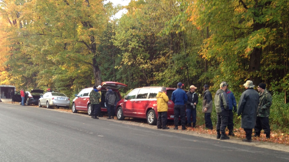 Police are searching a wooded area of Springwater Township, Ont. on Thursday, Oct. 9, 2014.