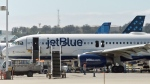 A JetBlue Airbus A320 airliner is seen at the Long Beach Airport in Long Beach, Calif., Thursday, Sept. 18, 2014. (AP / Damian Dovarganes)