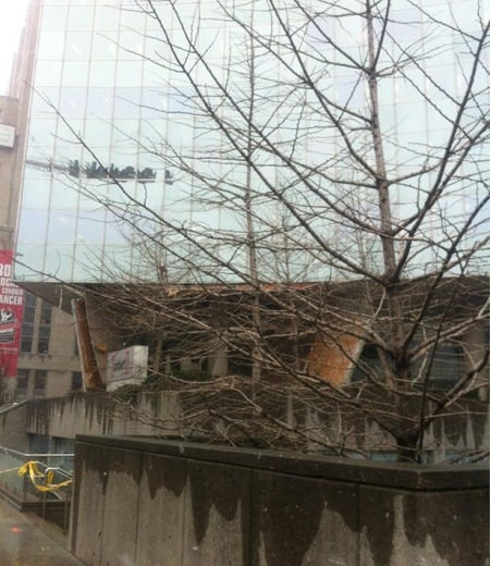A collapsed roof that fell from a high-rise building on University Avenue is seen in this image from Twitter, Wednesday, Feb. 29, 2012. (Tamara Cherry)