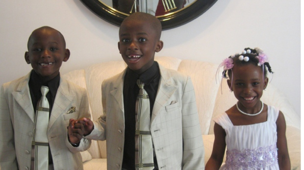This April 24, 2011 handout photo provided by the Lemon family shows Matthew Lemon, center, accompanied by his brother Joshua and sister Victoria in Randallstown, Md. Early diagnosis is considered crucial for autism, but studies show minority children are diagnosed later than white children. (AP Photo/Lemon Family)