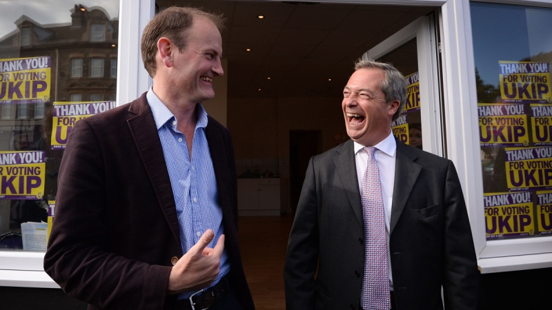 Newly elected UKIP MP for Clacton-on-Sea Douglas Carswell, left, celebrates with UKIP leader Nigel Farage. (AP / Stefan Rosseau, PA Wire)
