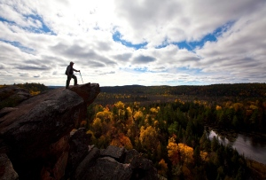 A hiker enjoys a view of fall colours from the Eagle's Nest look-out on the Manitou Mountain Trail near Calabogie, Ont. in 2010. (Sean Kilpatrick / THE CANADIAN PRESS)