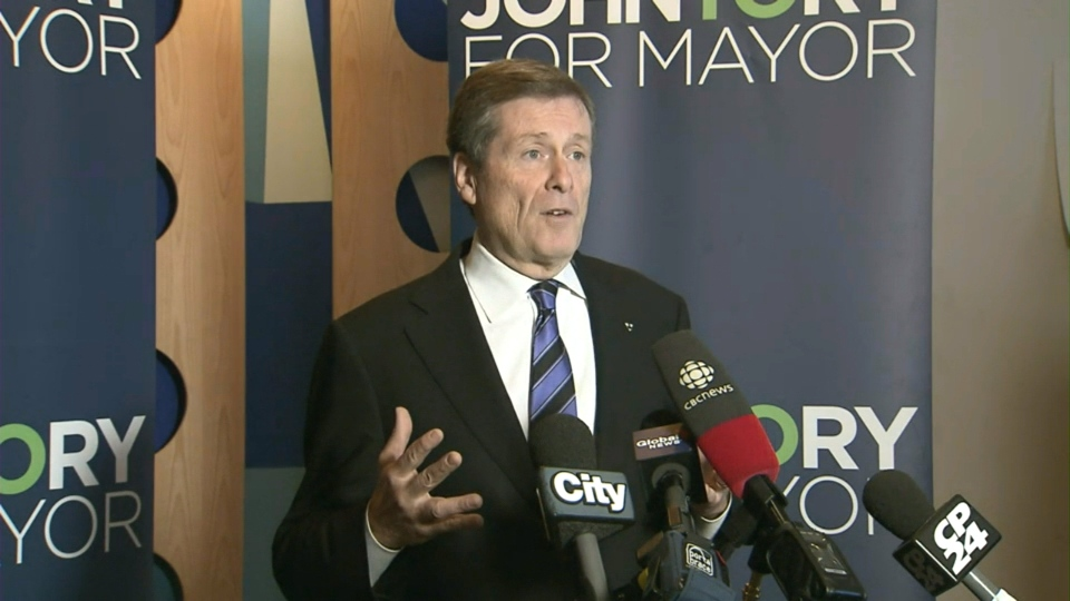 Mayoral candidate John Tory speaks with reporters about his plan to invest in the Toronto Community Housing Corporation repair backlog.