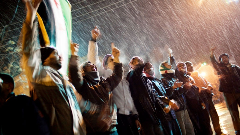Free Syrian Army supporters chant anti-government slogans under snowfall on the outskirts of Idlib, Syria, Wednesday, Feb. 29, 2012. (AP / Rodrigo Abd)