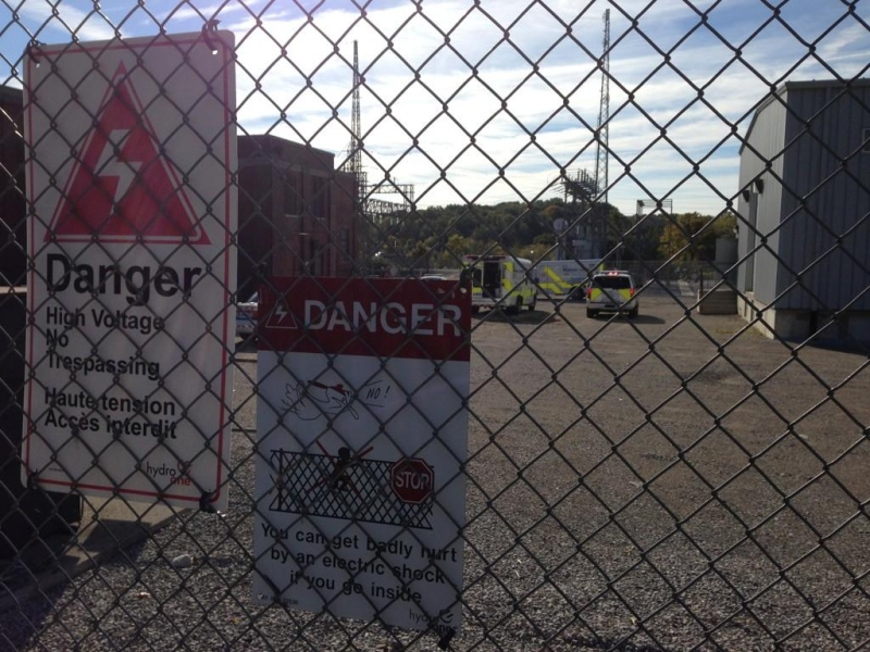 EMS crews work at the scene where a body was found at a Hydro One transformer station in London, Ont. on Friday, Oct. 10, 2014. (Bryan Bicknell / CTV London)