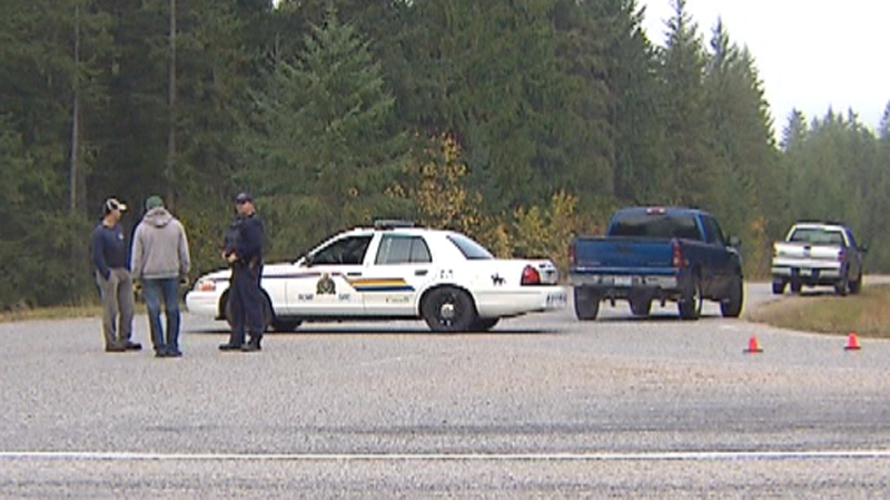 Investigators searched through the night near Slocan, B.C., where a suspect allegedly fired on police. (Curtis Allen for CTV)