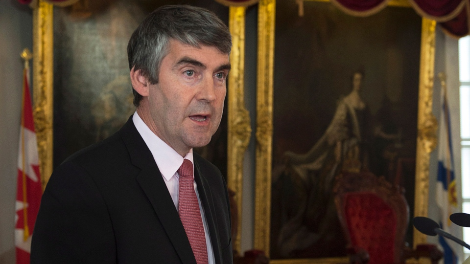 Premier Stephen McNeil extends an apology to the former residents of the Nova Scotia Home for Colored Children for the abuse and neglect they faced at the Halifax orphanage, at the legislature in Halifax on Friday, October 10, 2014. (Andrew Vaughan / THE CANADIAN PRESS)