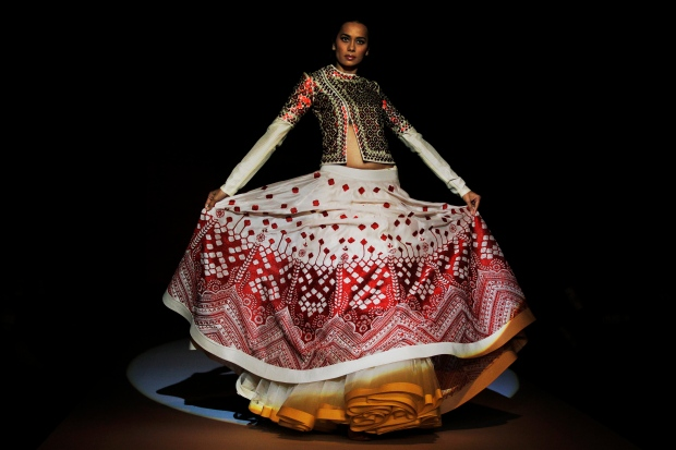 High fashion hits the runways in India for the bi-annual Wills Lifestyle Fashion Week in New Delhi. <br><br>  An Indian model displays a creation by designer Sahil Kochhar during Wills Lifestyle India Fashion Week, in New Delhi, India, Saturday, Oct. 11, 2014. (AP / Altaf Qadri)