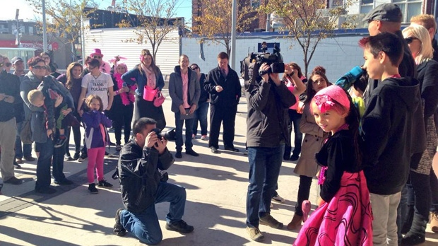 The family of 8-year-old Isabella Burgos and a couple dozen supporters rallied at Transcona Centennial Square on Saturday.