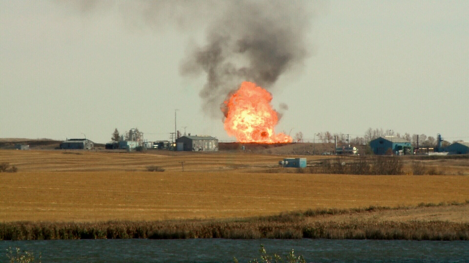 The fire at a Saskatchewan gas facility can be seen raging, emergency crews have ordered a 3km radius evacuation following an explosion that sparked the blaze. Oct. 11, 2014.
