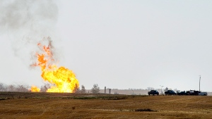 Remaining gas is burned off after explosion and fire at a gas pumping station owned by TransGas near Prud'homme, Sask., Saturday, October 11, 2014. (Liam Richards / THE CANADIAN PRESS)