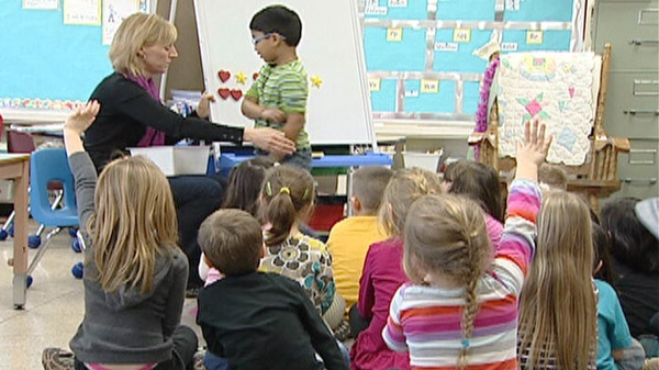 Kindergarten students are seen with their teacher at their school in Breslau, Ont.