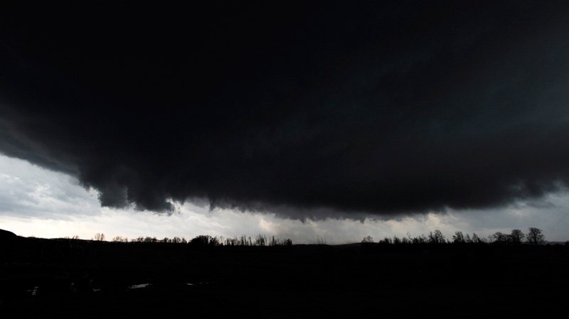 Storm clouds move over west of Palmyra, Ind., on Friday, Mar. 2, 2012  (AP / The Courier-Journal,David Lee Hartlage)