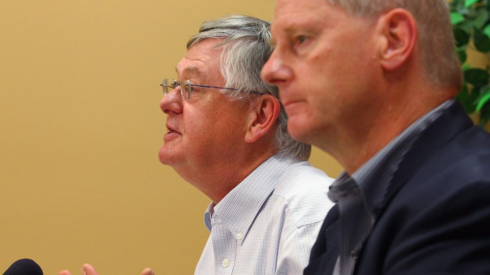 Dr. Richard Schabas (left), medical officer of health for Hastings and Prince Edward County, and Dr. Dick Zoutman, chief of staff at Quinte Health Care, speak to media at Quinte Health Care hospital in Belleville, Ont., on Monday, Oct. 13, 2014. (Lars Hagberg / THE CANADIAN PRESS)
