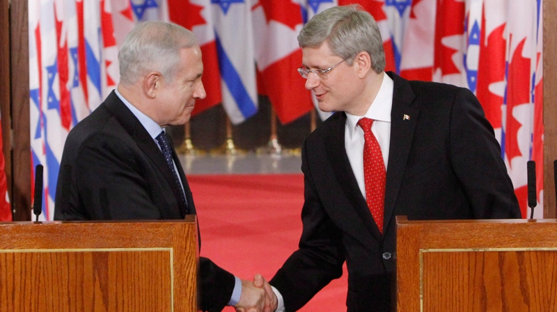 Prime Minister Stephen Harper shakes hands with they Israeli Prime Minister Benjamin Netanyahu hold a joint news conference in Ottawa, Friday, March 2, 2012. (Fred Chartrand  / THE CANADIAN PRESS)